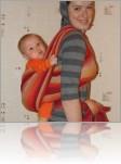 Самый многофункциональный и самый дорогой! Можно использовать с рождения и до 2 лет, не трудно кормить грудью, но многих начинающих слингомам может пугать необходимость заматывать на себя 3-метровый кусок ткани.